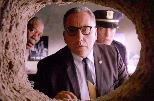 Men looking through a tunnel: scene from Shawshank Redemption
